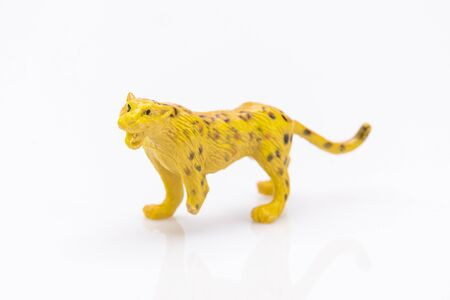 Photo pour close up of a plastic panther toy isolated on a white background - image libre de droit
