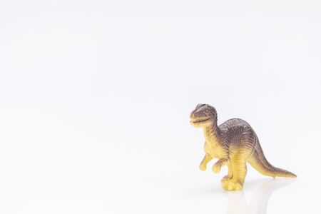 Photo pour close-up of a colorfull plastic dinosaur figurine isolated on a white background - image libre de droit