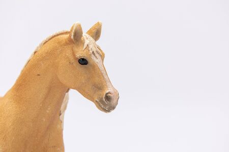 Photo pour close up of a brown plastic horse isolated on a white background - image libre de droit