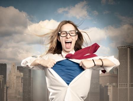 Foto de woman opening her shirt like a hero - Imagen libre de derechos