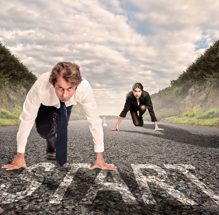 Photo for man versus woman on a road ready to run - Royalty Free Image