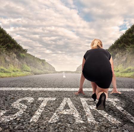 Photo pour businesswoman on a road ready to run. Motivation concept - image libre de droit