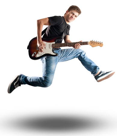 Photo pour young man jumping with electric guitar on white background - image libre de droit