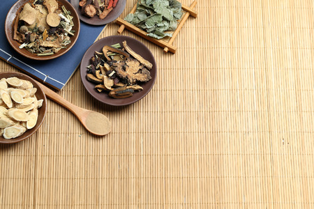Photo for Traditional Chinese medicine on bamboo desk - Royalty Free Image