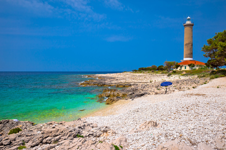 Foto de Veli Rat lighthouse and turquoise beach view, Dugi Otok island, Dalmatia, Croatia - Imagen libre de derechos