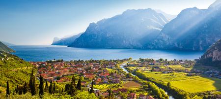 Photo pour Town of Torbole and Lago di Garda sunset view, Trentino Alto Adige region of Italy - image libre de droit