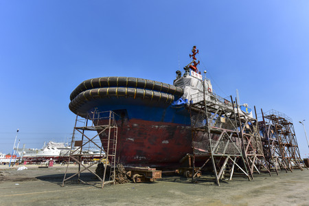 Foto per A ship being repaired at a ship repair plant - Immagine Royalty Free