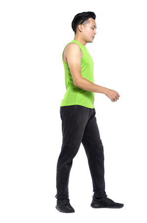 Foto per Full body length portrait of young fit man in sportswear, standing over white background - Immagine Royalty Free