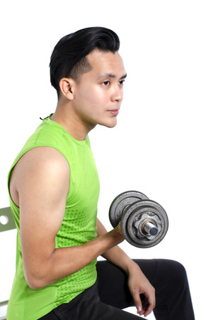 Foto per healthy lifestyle concept, young fit man in sportswear , holding dumbbell over white background - Immagine Royalty Free