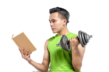 Foto per healthy lifestyle concept, cropped face young fit man in sportswear, holding dumbbell and book over white background - Immagine Royalty Free