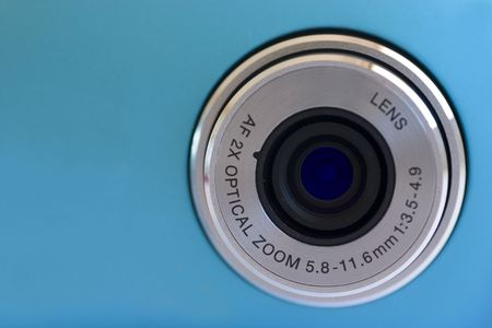 Isolated digital camera lens over blue