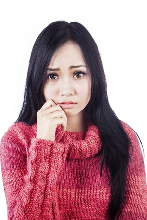Portrait of sad woman wearing red sweater. isolated on white bakground