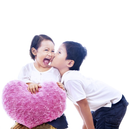 Loving brother kissed his sister on white background
