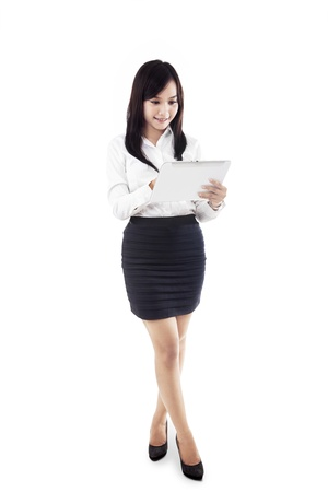 Businesswoman holding electronic tablet isolated in white