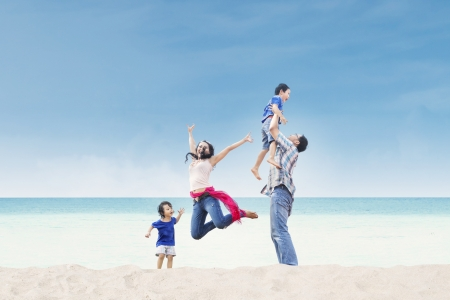 Photo for Asian family having fun at the beach - Royalty Free Image