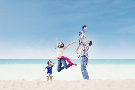 Asian family having fun at the beach