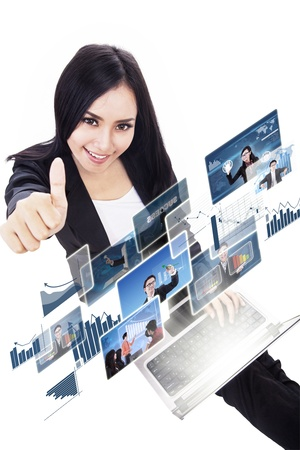Businesswoman showing thumbs up while choosing online pictures on laptop, isolated on white