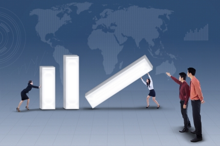 Business team building profit bar chart together while business manager looking at them on blue world map background
