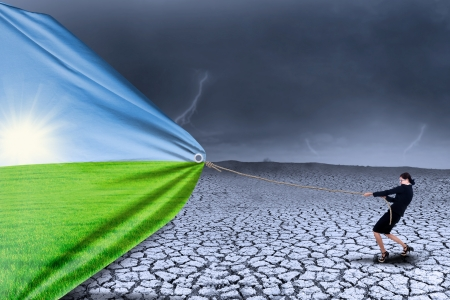 Photo for Businesswoman changing reality of drought to spring season - Royalty Free Image