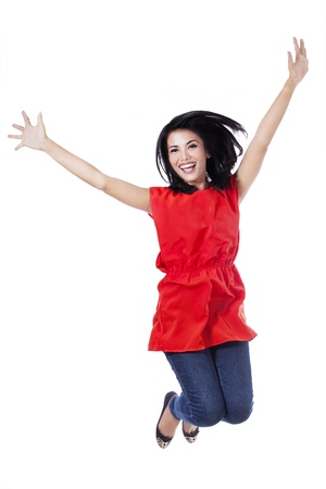 Happy attractive woman jumping in the air - isolated over a white background