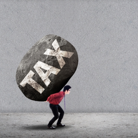 Photo pour Concept of stress of a businessman carrying a big rock of TAX - image libre de droit