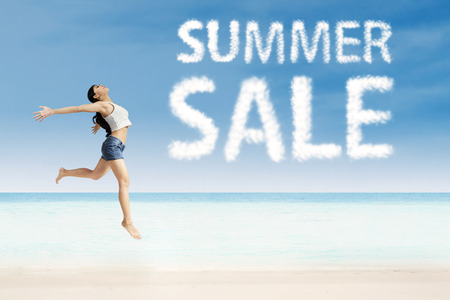 Joyful woman jumping on the air with summer sale design