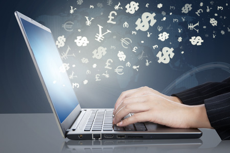Photo for Image of businesswoman hands working on the laptop computer with currency symbols. Making money online concept - Royalty Free Image