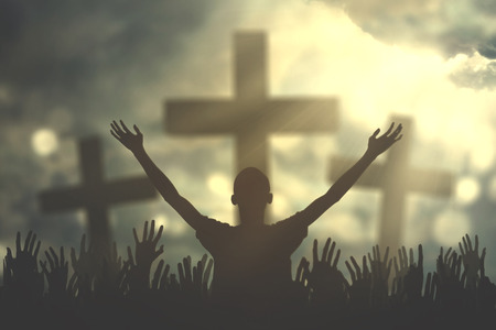 Photo pour Silhouette of christian prayers raising hand while praying to the GOD with three cross symbols - image libre de droit