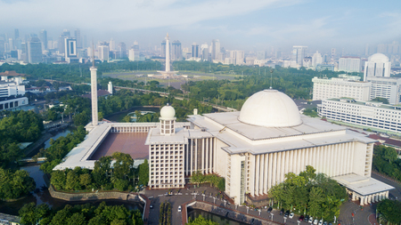 Photo for City panorama with Istiqlal Mosque and skyscrapers under blue sky at Jakarta, Indonesia - Royalty Free Image