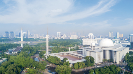 Photo for Aerial view of Istiqlal Mosque with skyscrapers under blue sky at Jakarta, Indonesia - Royalty Free Image