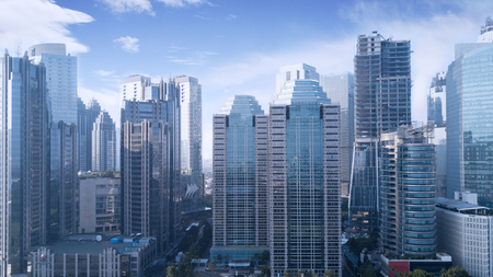 Foto de Beautiful aerial view of office buildings under blue sky in Jakarta, Indonesia - Imagen libre de derechos