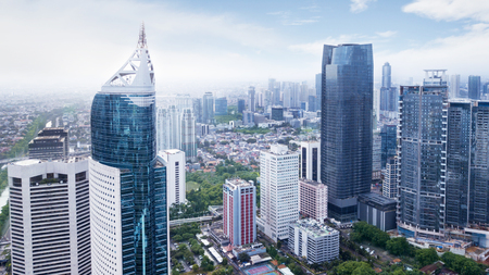 Foto de JAKARTA, Indonesia. January 27, 2018: Aerial view of Jakarta office buildings in Sudirman Central Business District shot from a drone at mid day - Imagen libre de derechos