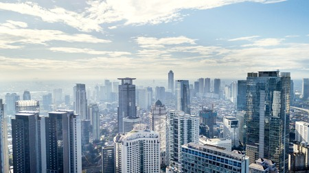 Photo pour JAKARTA - Indonesia. March 12, 2018: Jakarta skyline with modern office and apartment buildings at sunny day - image libre de droit