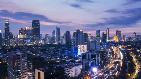 Foto de Beautiful aerial landscape of central business district of Jakarta from a drone at sunset time - Imagen libre de derechos
