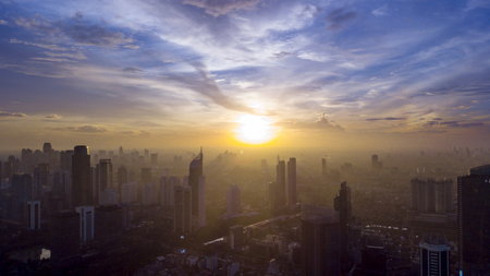 Photo pour Top view of beautiful skyscrapers covered by mist at morning time in Jakarta, Indonesia - image libre de droit