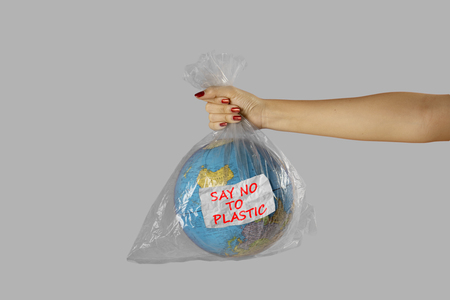Foto per Concept of World Environment Day. Unknown woman holding a plastic with world globe and text of say no to plastic - Immagine Royalty Free