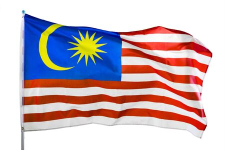 Foto de Close up of Malaysia flag waving in the wind on a flagpole, isolated on white background - Imagen libre de derechos