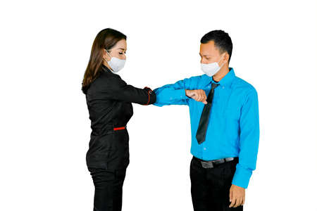 Two business people wearing medical mask while talk and meet in the studio. Isolated on white background