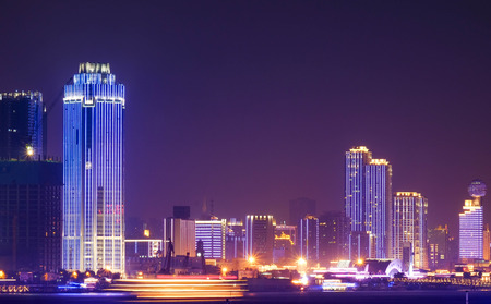 Photo pour At the riverside and night time at the Yantze River of Wuhan City of China. is special name. Lighting in many building in there. - image libre de droit