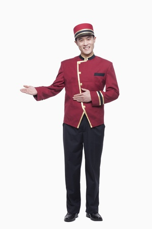 Photo pour Portrait of Bellhop, Greeting, studio shot - image libre de droit