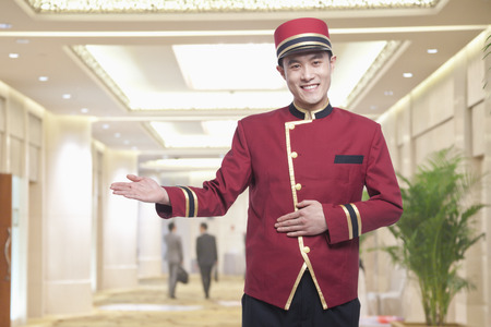 Photo pour Portrait of Bellhop, Greeting - image libre de droit