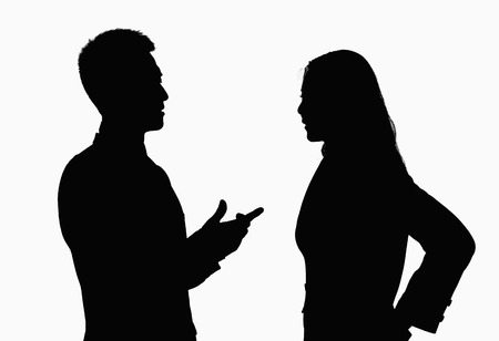 Photo pour Silhouette of businessman and businesswoman talking. - image libre de droit
