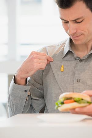 Photo pour Man with mustard on his shirt - image libre de droit