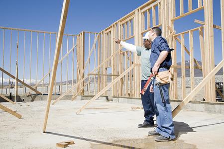 Photo pour Builders on construction site - image libre de droit