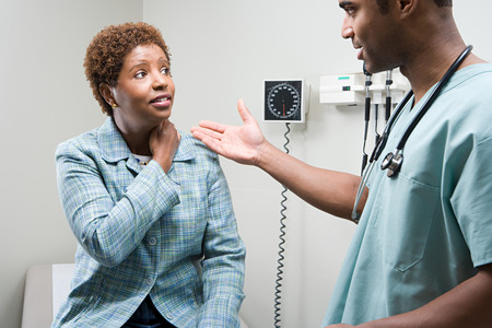 Photo for Woman talking to doctor - Royalty Free Image