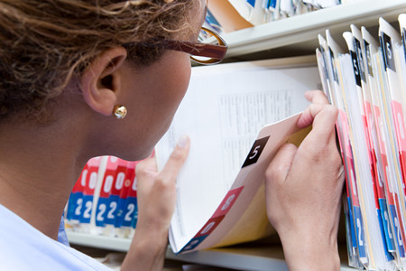 Photo pour Administrator looking at medical record - image libre de droit
