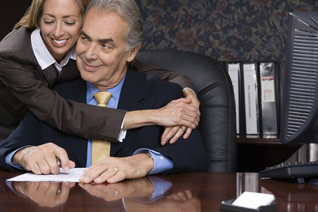 Photo for Woman hugging her boss - Royalty Free Image