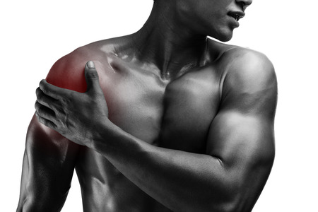 Photo pour young muscular man with shoulder pain , isolated on white background - image libre de droit