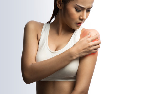 Photo pour young muscular woman with shoulder pain, on white background with clipping path - image libre de droit