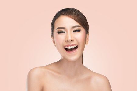 Photo for Beauty portrait of skin care beauty woman laughing smiling happy and cheerful. Asian female beauty model on pink background. - Royalty Free Image